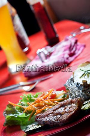 pork steak and zucchini with salad