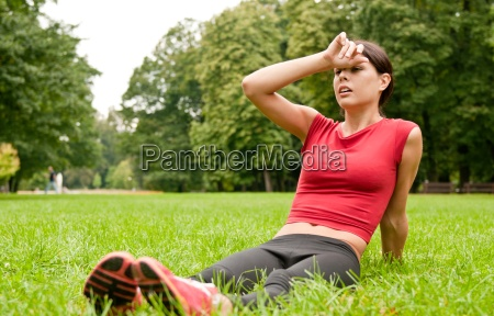 relax in grass tired woman