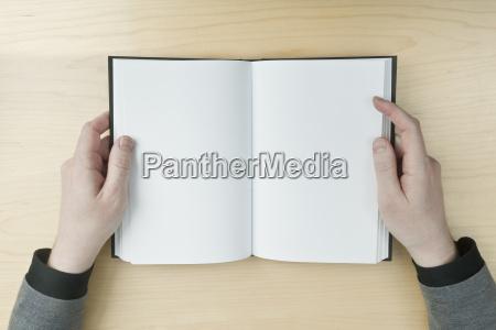 man reading a blank book