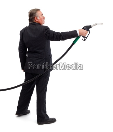 business man pointing with gas nozzle