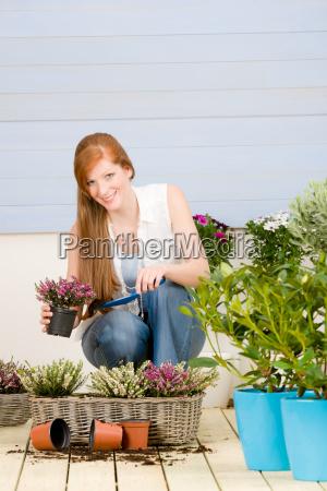 summer garden terrace redhead woman hold