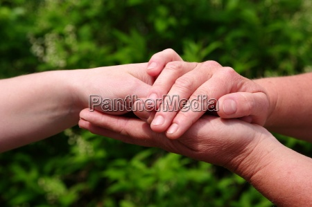 hands hold each other and give
