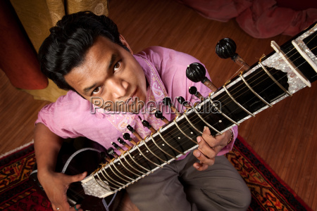 indian man playing sitar