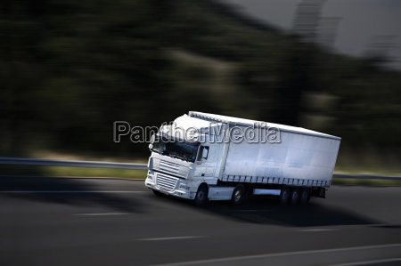 speed yellow semi truck on highway