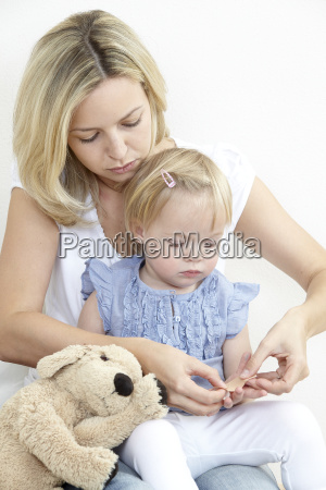 mother and daughter with plaster
