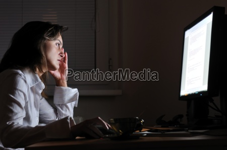 business person working overtime with neck