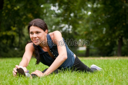 woman performs stretching before sport in