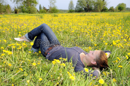 young woman lying on a flower