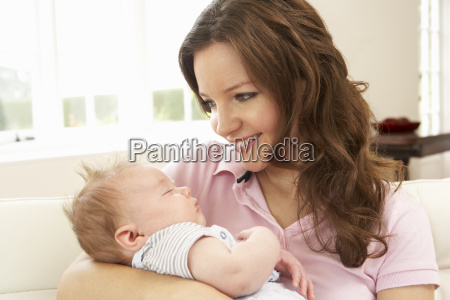 close up of affectionate mother cuddling