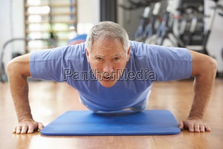senior man doing press ups in