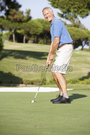 senior male golfer on golf course