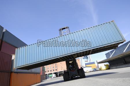forklift hoisting cargo container