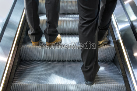 two men on an escalator