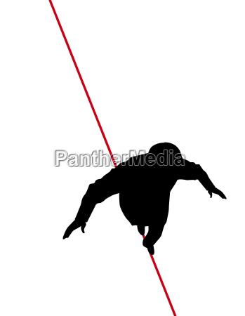 man walking tight rope