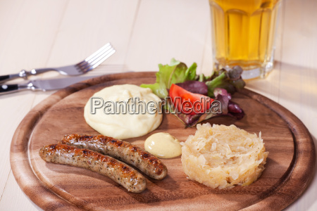 two sausages on a wooden board
