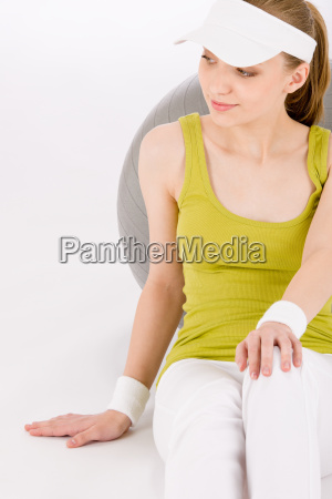 fitness teenager woman in sportive outfit
