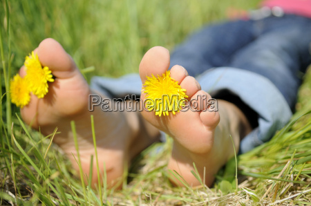 young woman lies barefoot in a