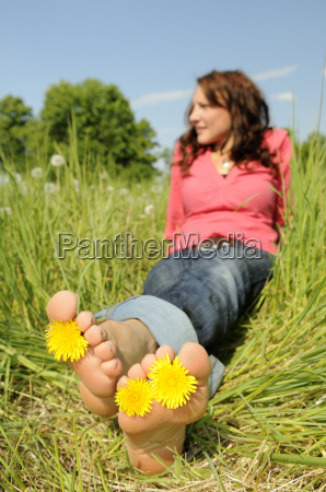 young woman is barefoot in a