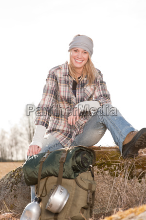 camping young woman in countryside backpack