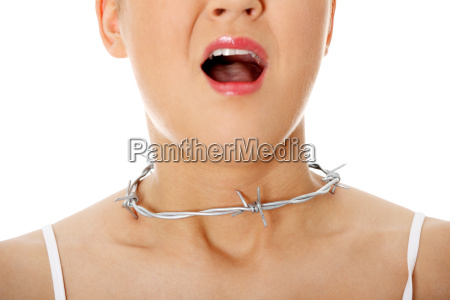 young woman with barbed wire around