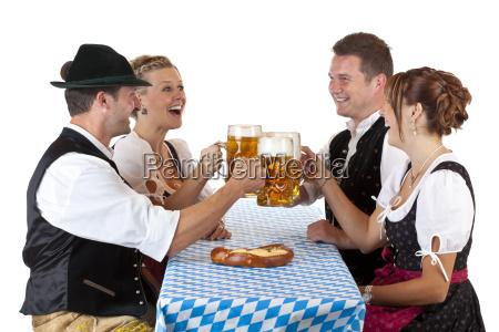 bavarian men and women clinking oktoberfest