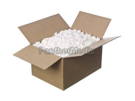open cardboard box with peanuts