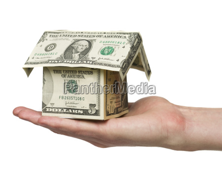 hand holding a small house built