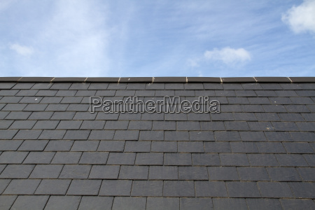 slate roof against blue sky