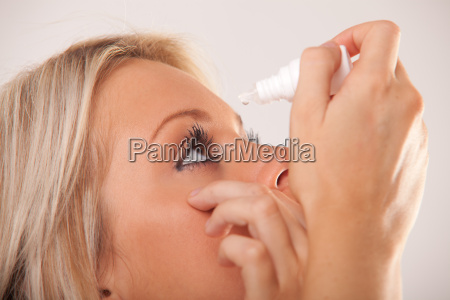 womans eye and eyedropper with waterdrop