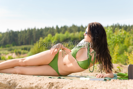 summer beach stunning woman sunbathing in