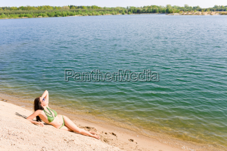 summer woman in bikini alone on