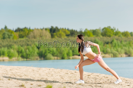 summer sport fit woman stretching on
