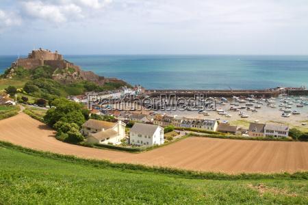 mont orgueil with harbor in gorey