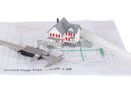 toy house model and ruler and