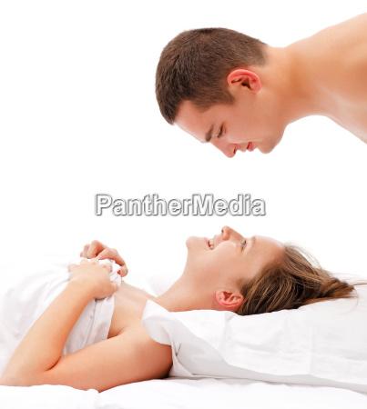 man bending over woman