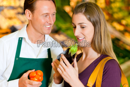man in supermarket as a salesman
