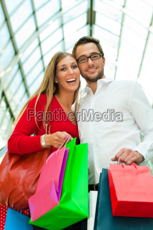 man and woman on a shopping