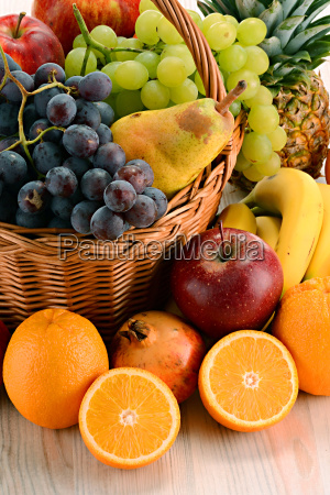 composition with fruits and wicker basket