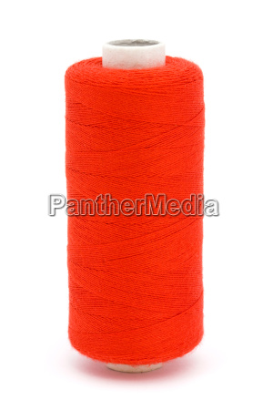 red cotton reel over white