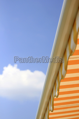 yellow sun awning against blue sky