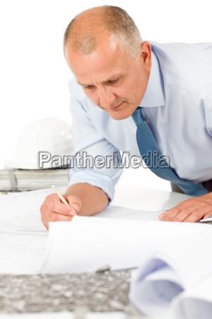senior, man, work, on, blueprints, construction - 4997699