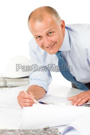 senior, man, work, on, blueprints, construction - 4997705
