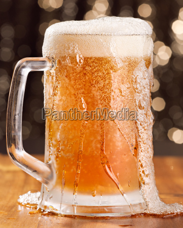 overflowing mug of beer