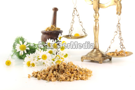 chamomile flowers with mortar and scale