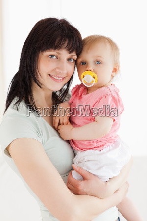 good looking woman holding her baby