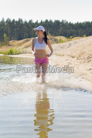 summer sport fit woman jogging along
