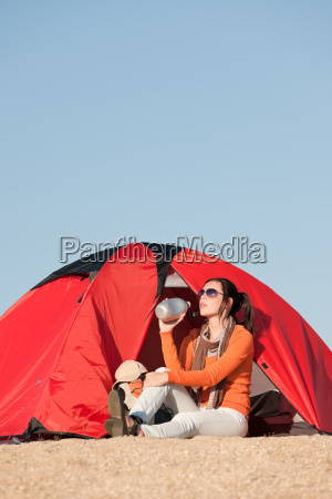 camping happy woman sitting front of