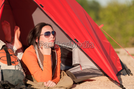 camping happy woman in tent on