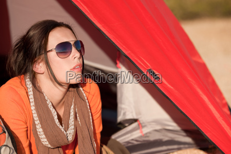 camping happy woman lying in tent