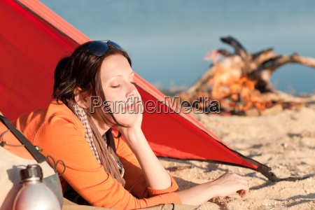 camping woman relax in tent by